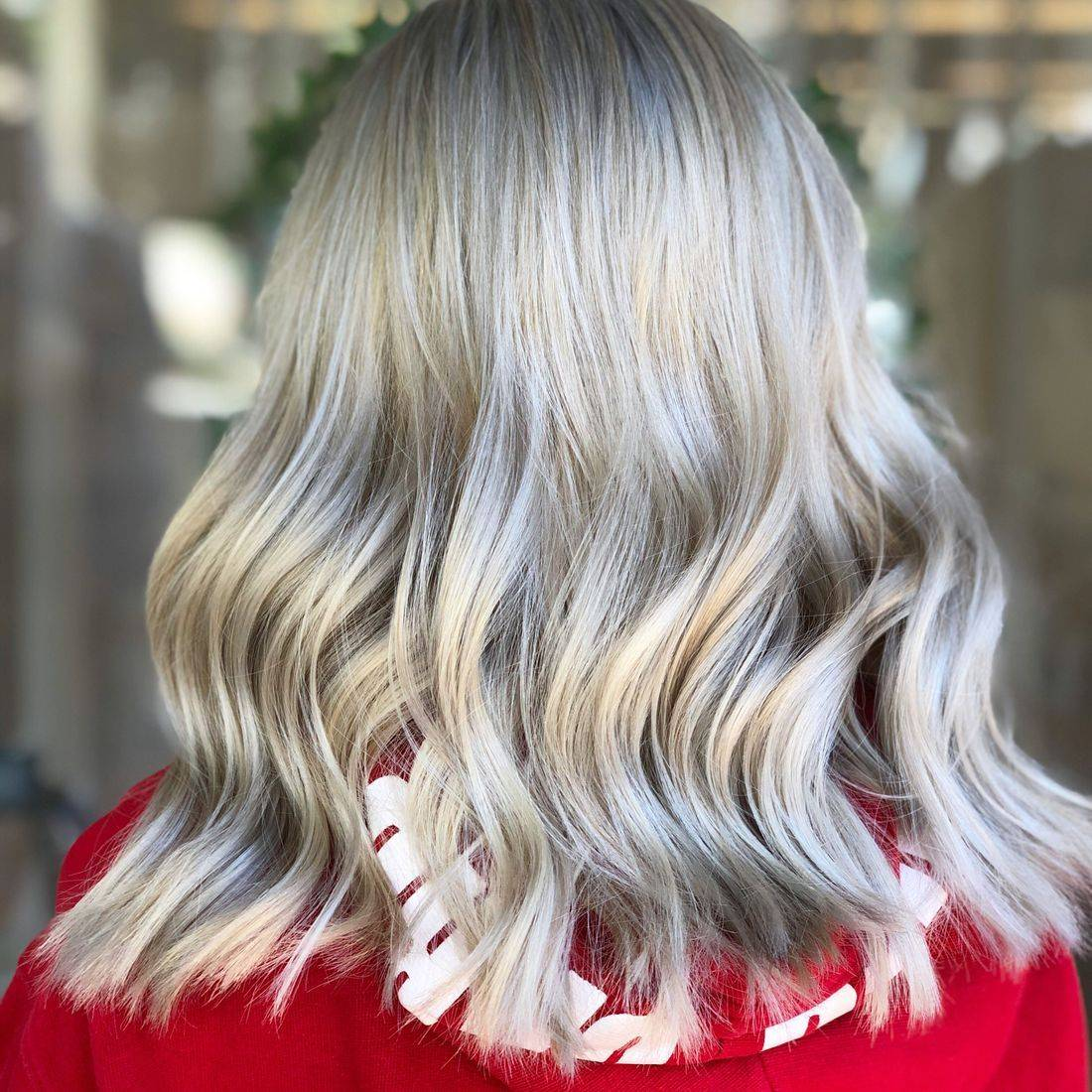Textured blonde balayage and baby lights