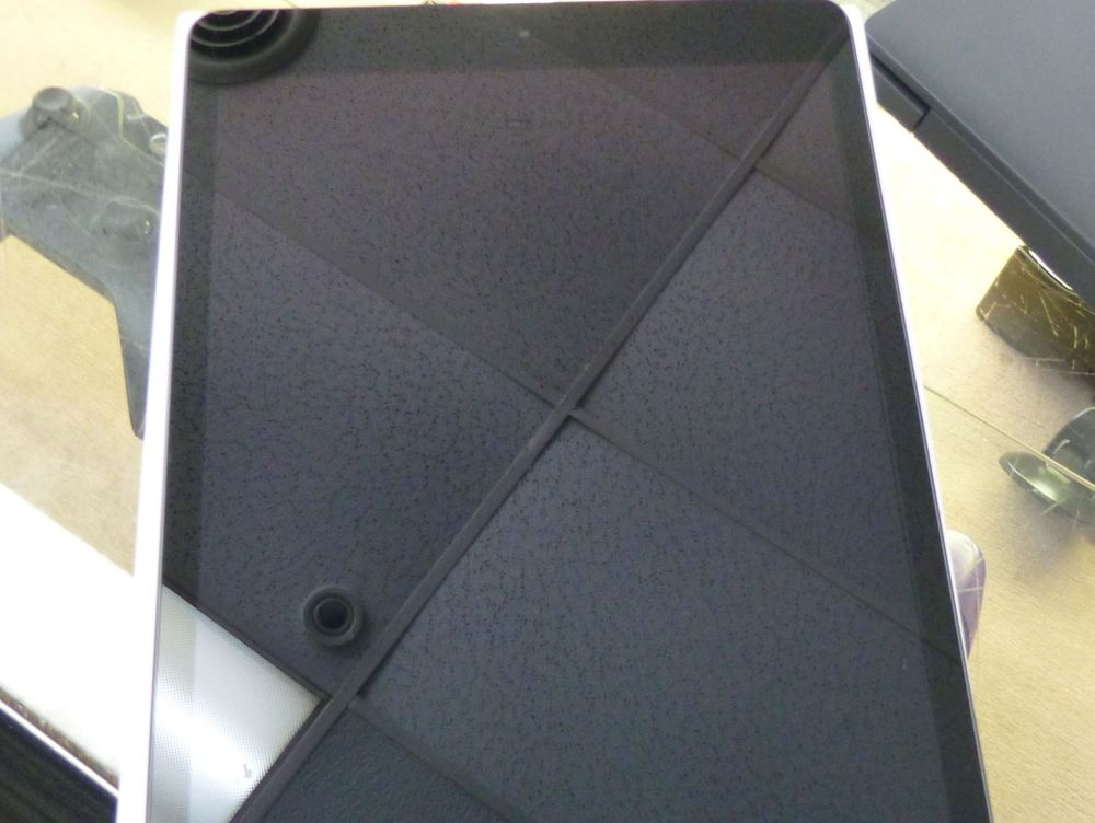 """Closeup picture of an Apple iPad 10.2"""" laying on a countertop"""