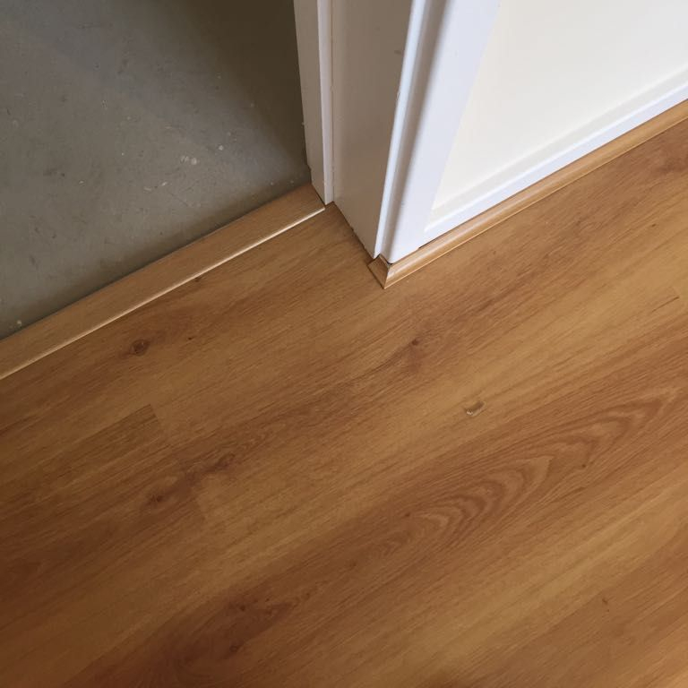 Laminate fitted to doorway with Scotia and doorbar