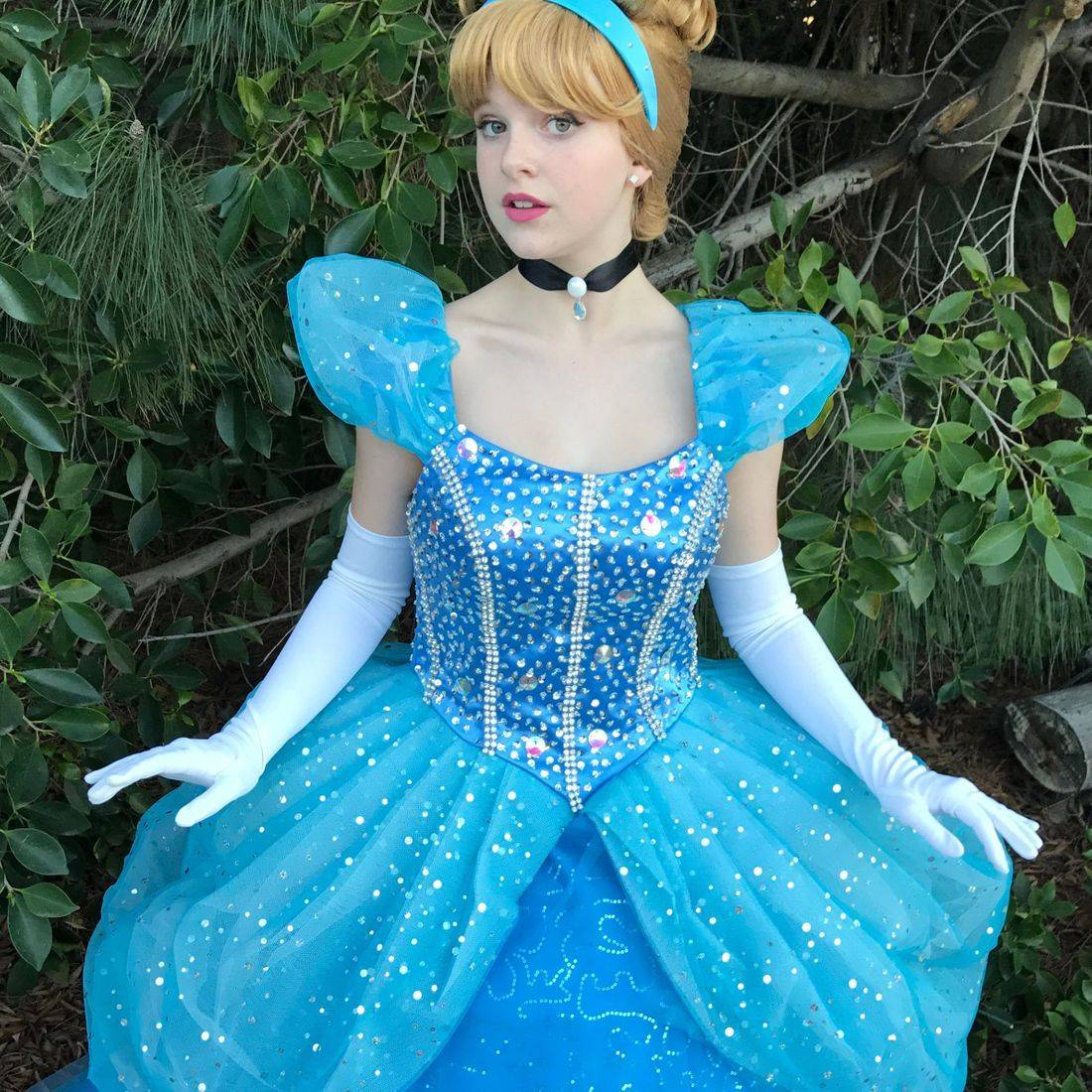 Princess  Cinderella in an embellished blue sequin gown .