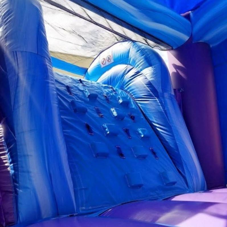 Purple marble castle bounce house dry slide combo