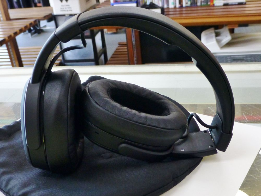 Closeup picture of black skullcandy crusher wireless over the ear headphones