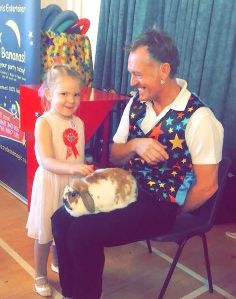 Stroking the rabbit at the end of the show