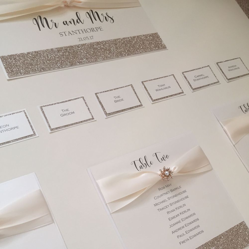 Ivory table plan with champagne gold glitter