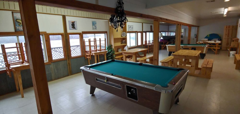 Pool tables, spacious, tables, river view, benches, dining, food