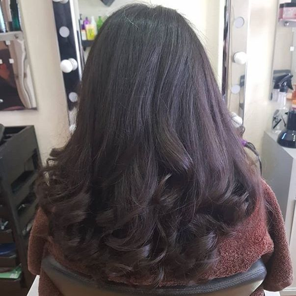Curly blow dry hairdresser hair salon colour balayage highlights