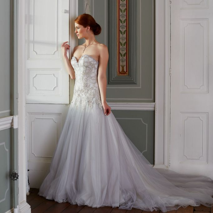 Crystals over the bodice, full tulle skirt
