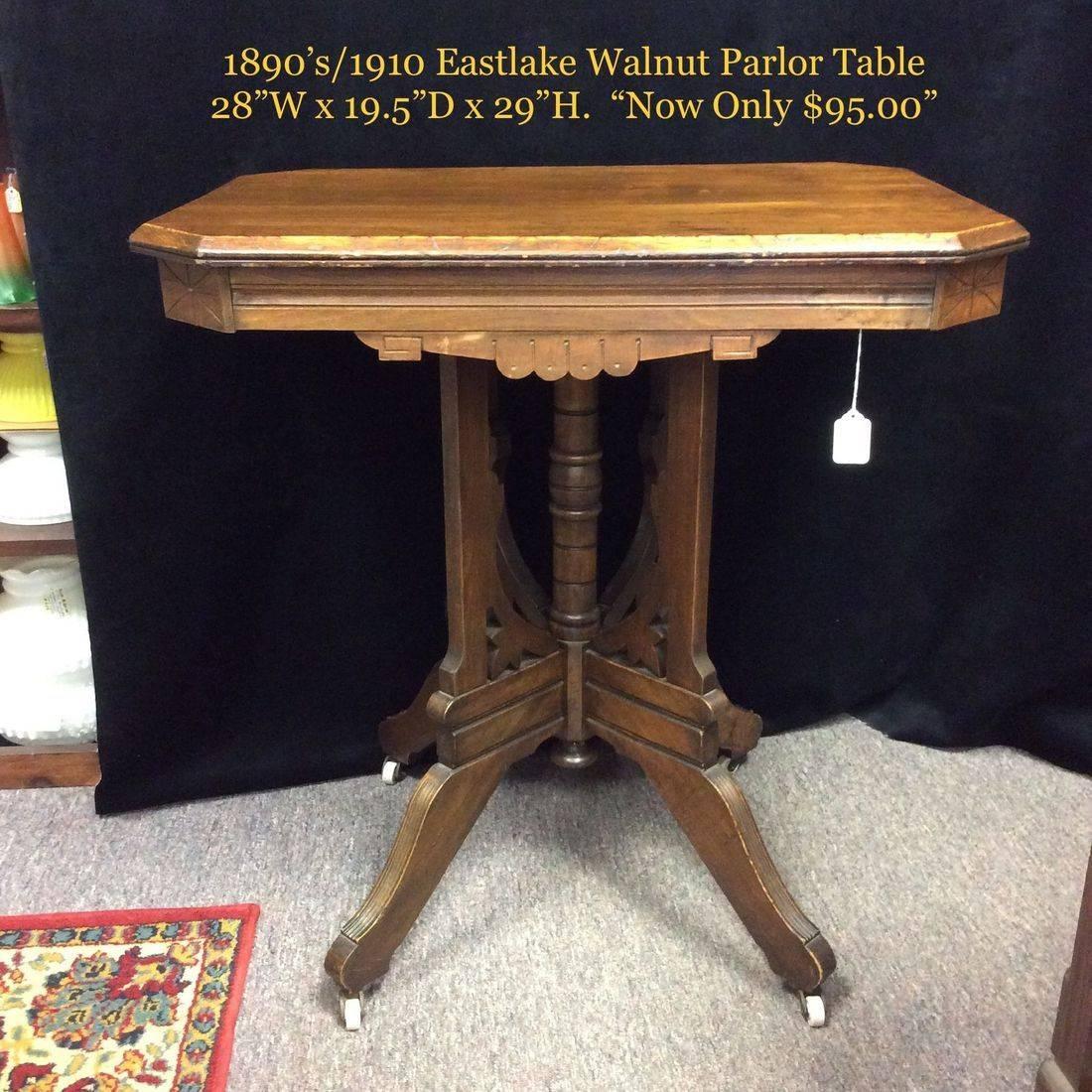 1890's/1910 East Lake, Walnut Parlor Table w/Porcelain Wheels   $95.00
