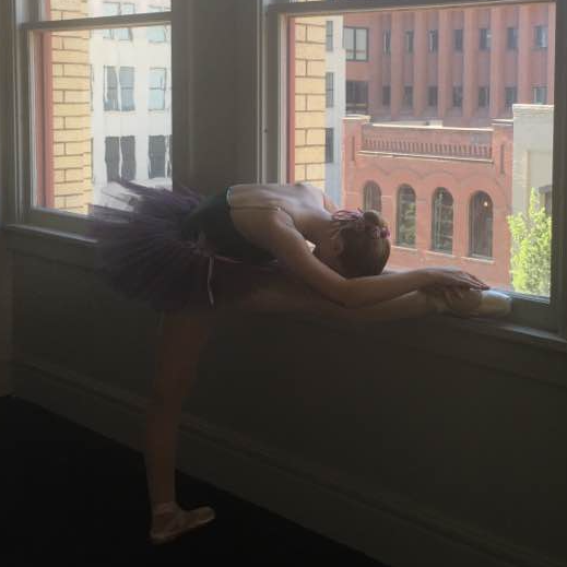 Our dancer stretches before our ballet performance in downtown Spokane.