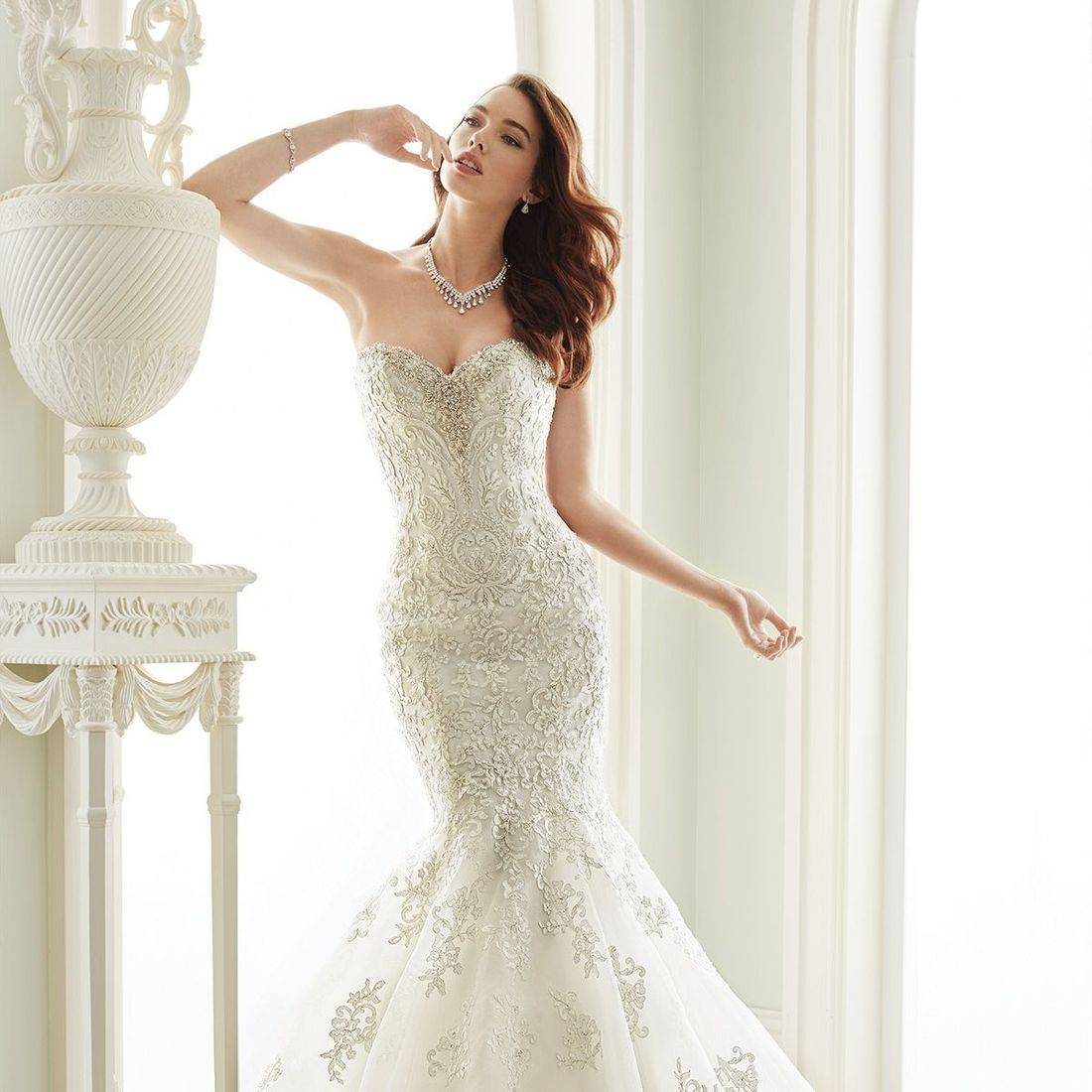 sophia tolli, sophia tolli wedding dress, organza wedding dress, fitted wedding dress, strapless wedding dress, elongated bodice wedding dress, sparkly wedding dress, ruffled wedding dress, sweetheart neckline wedding dress,