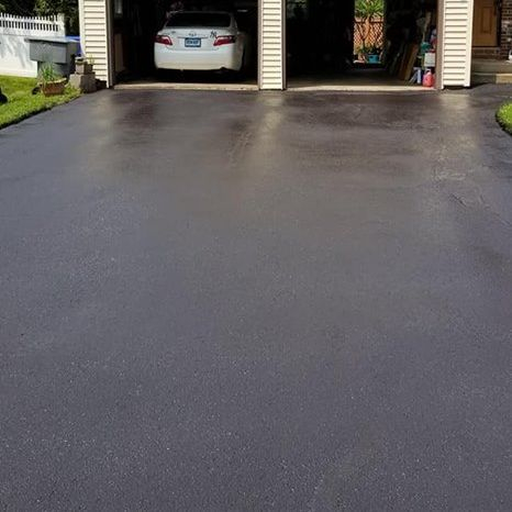 Repaired crack and seal-coated driveway.