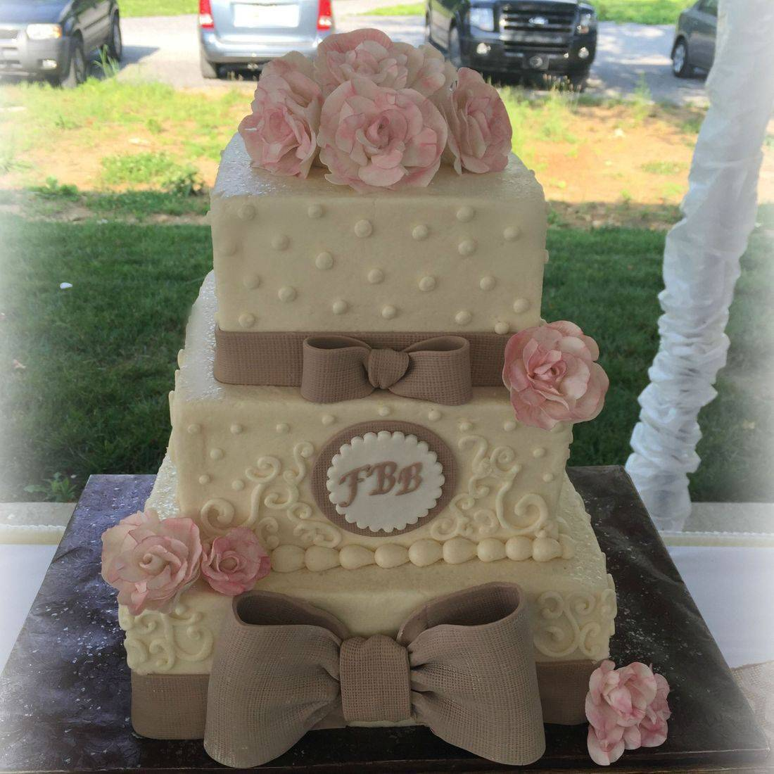 Buttercream Wedding Cake Ruffles scrolling Bow