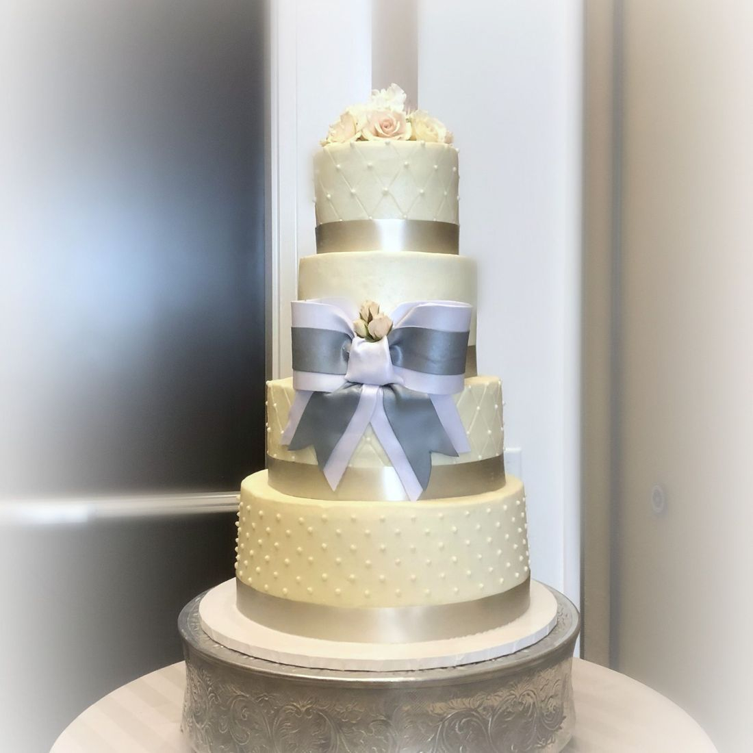 buttercream quilted and swiss dots wedding cake 4 tier