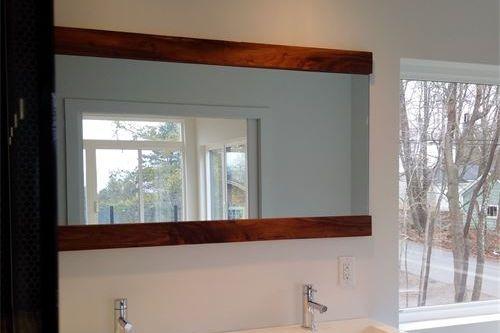 Walnut framing on bathroom mirror