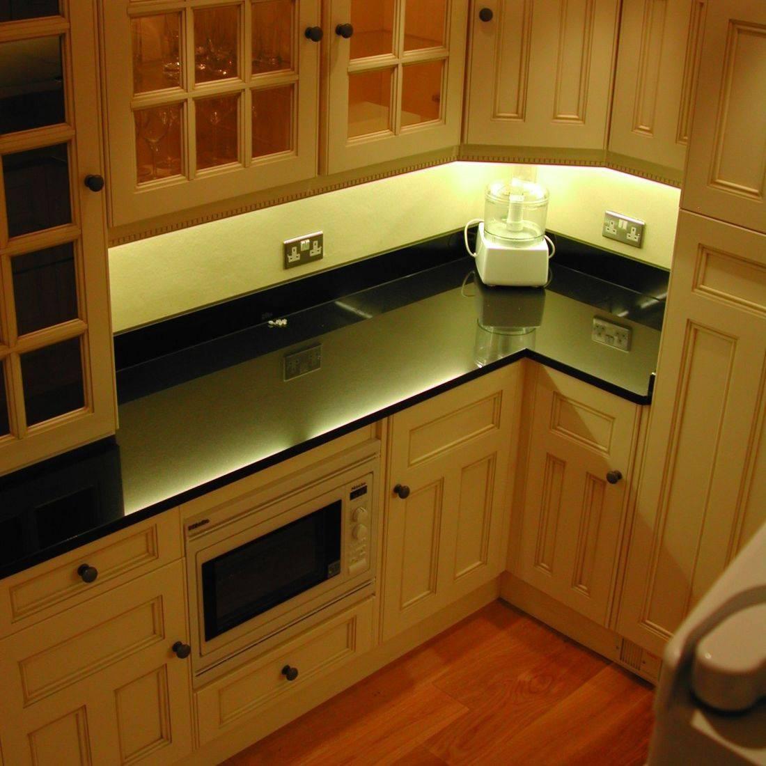 Cream Fitted Kitchen Black Granite Worktops Oak Floor