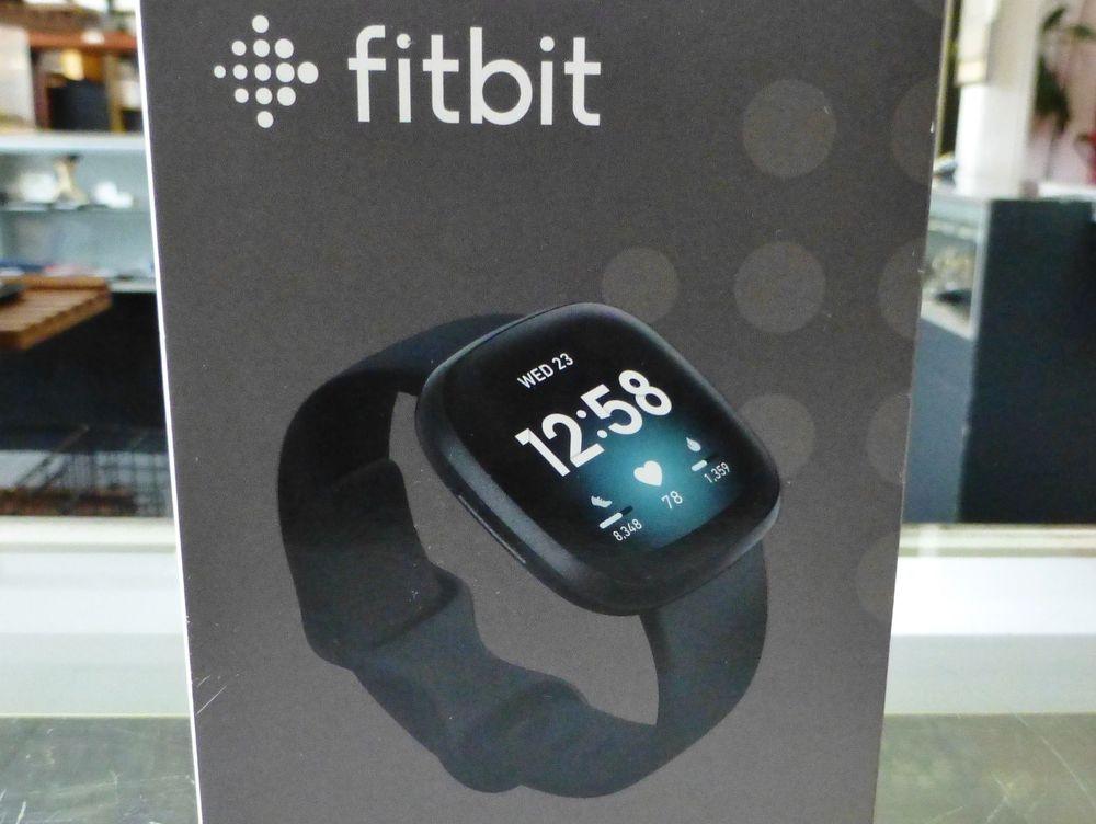 fitbit versa 3 smart watch in a gray box