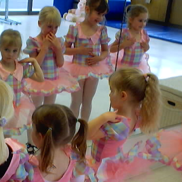 We love to see their faces when they see themselves in the mirror at costume try on class.