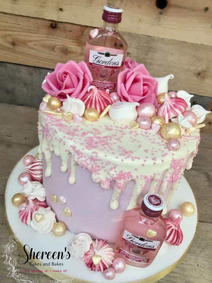 birthday cake drip pink gin bottles roses meringues lustre balls gold hearts