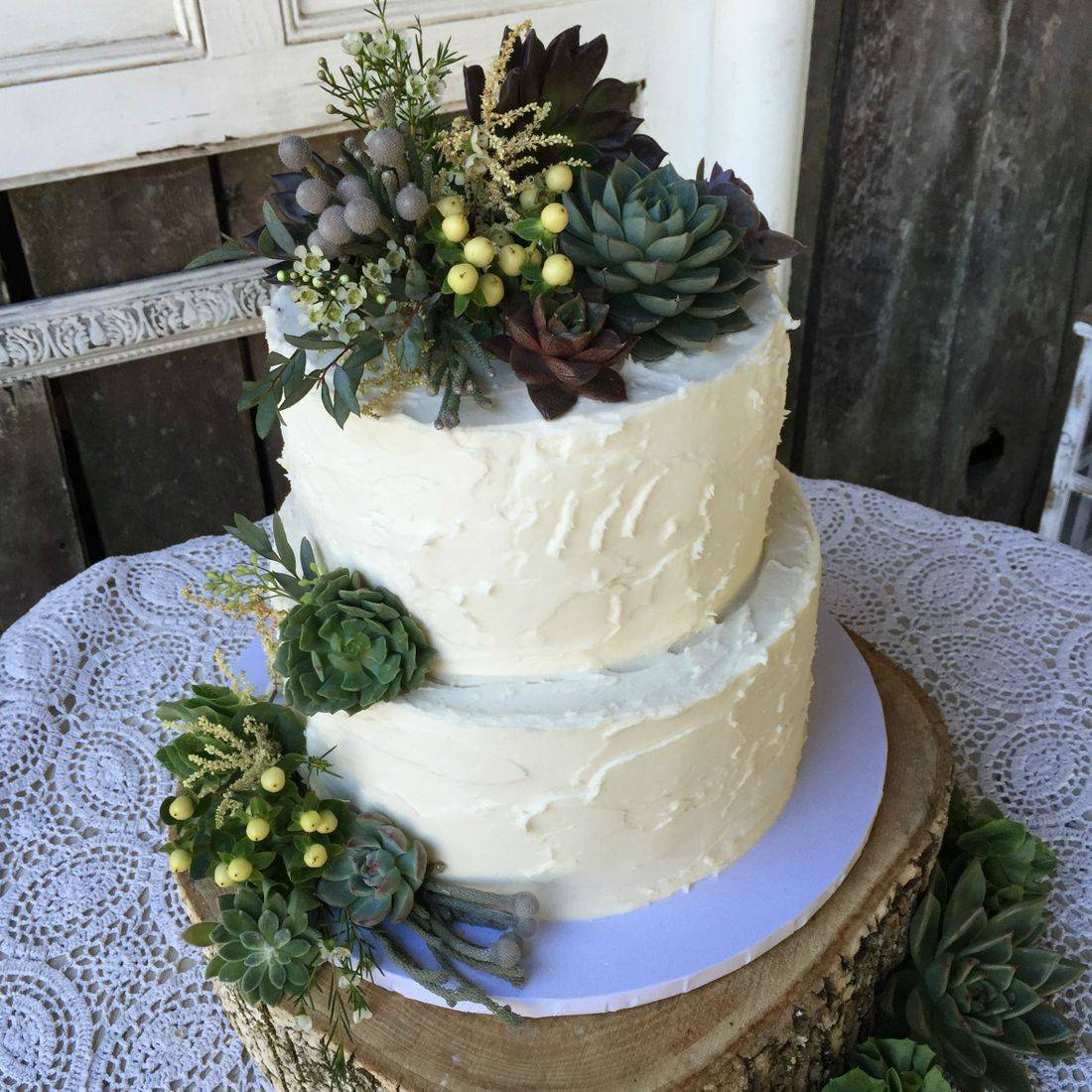 buttercream wedding cake succulents and flowers green and lavender