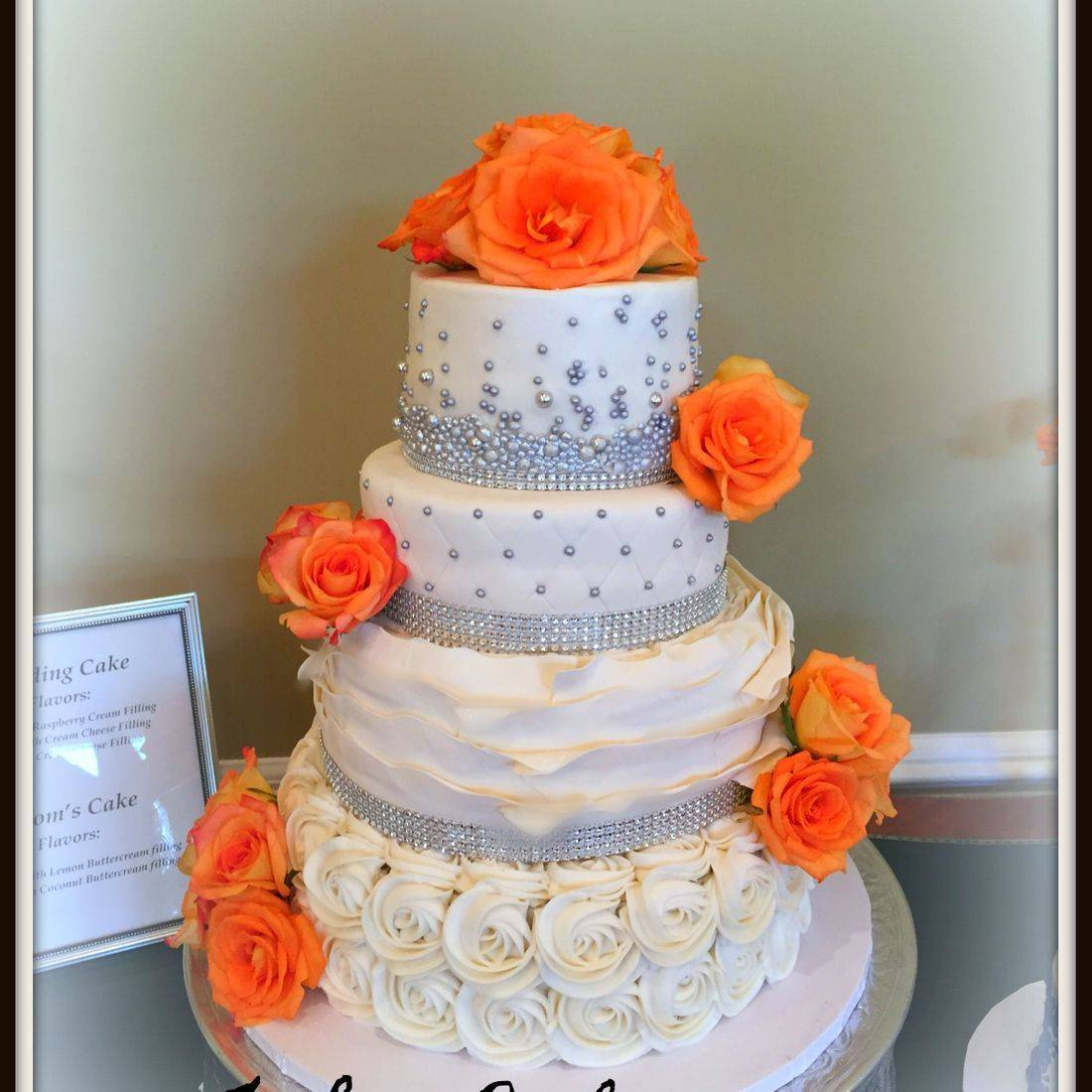 silver and white pearl wedding cake buttercream fresh flowers orange