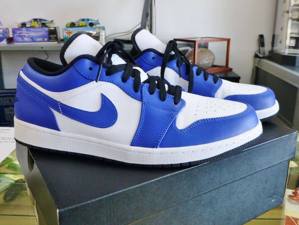 Closeup picture of a pair of blue and white nike air jordan 1 retro low sneakers on box