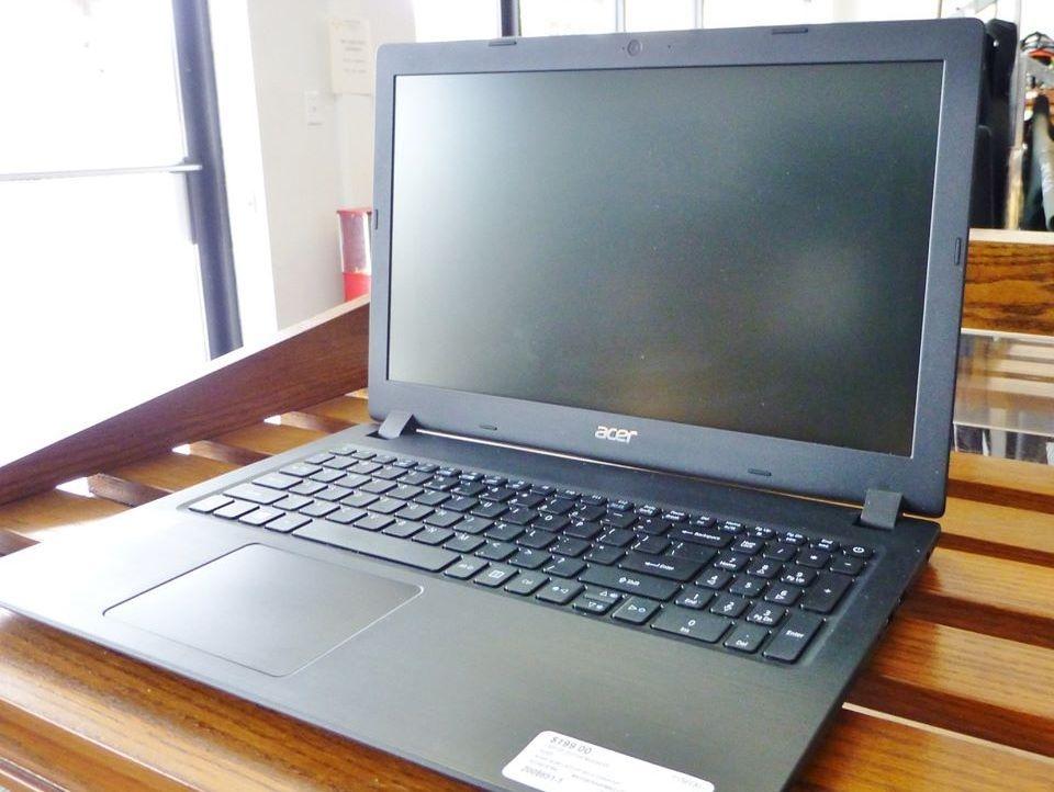 Acer Aspire Gray Laptop on slatted wooden shelf