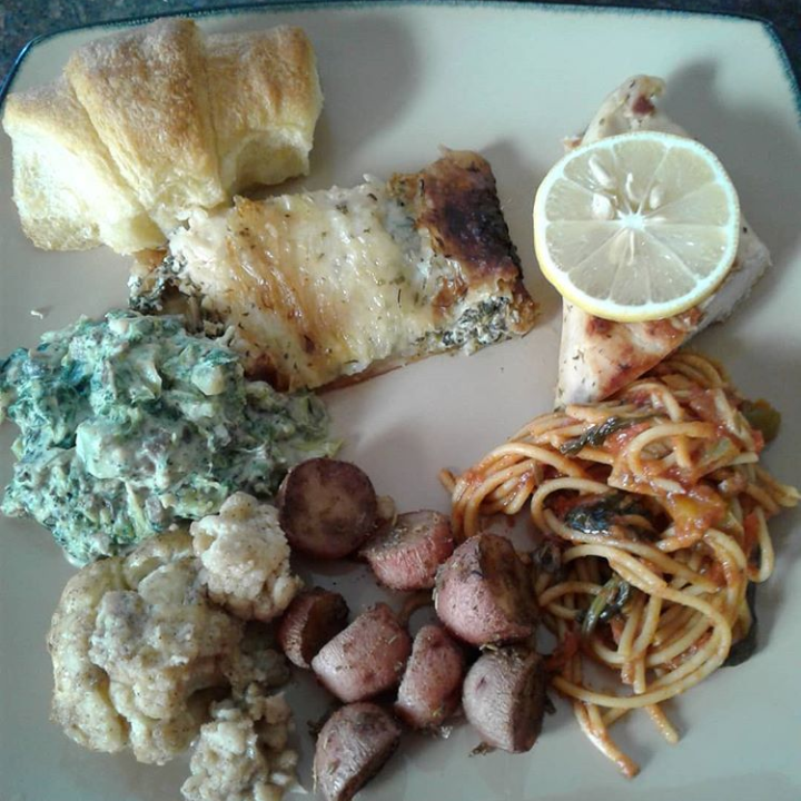 Salmon Wellington, herb chicken,  rosemary potatoes, sauteed spinach and artichoke, spaghetti with chunky veggie sauce