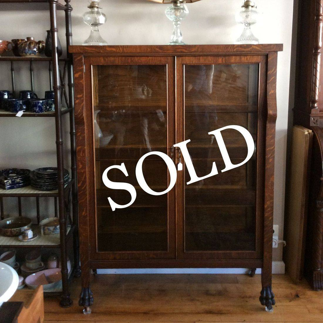 "C. 1910/1920's Oak 4-Shelf China Cabinet w/Claw Feet - 44-1/4""W x 16-1/2""D x 59""H.  $325.00"