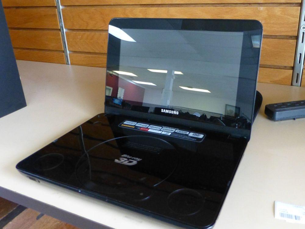 black portable dvd player on a shelf