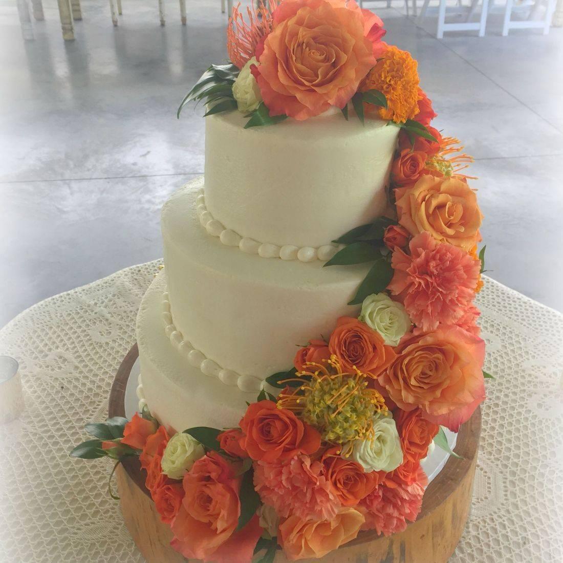 buttercream wedding cake fresh flowers smooth buttercream