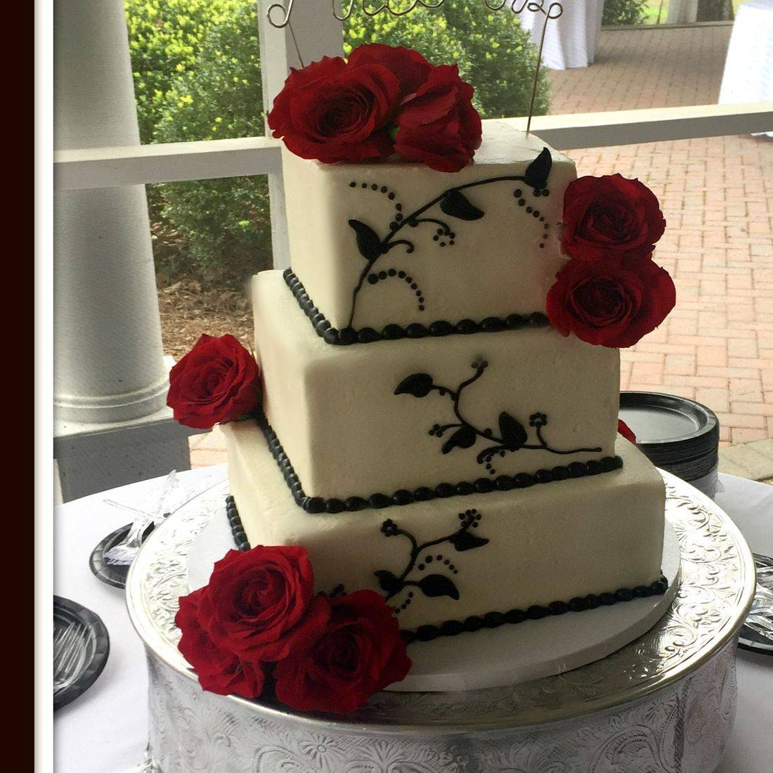 Buttercream Wedding Cake black scrolls red roses