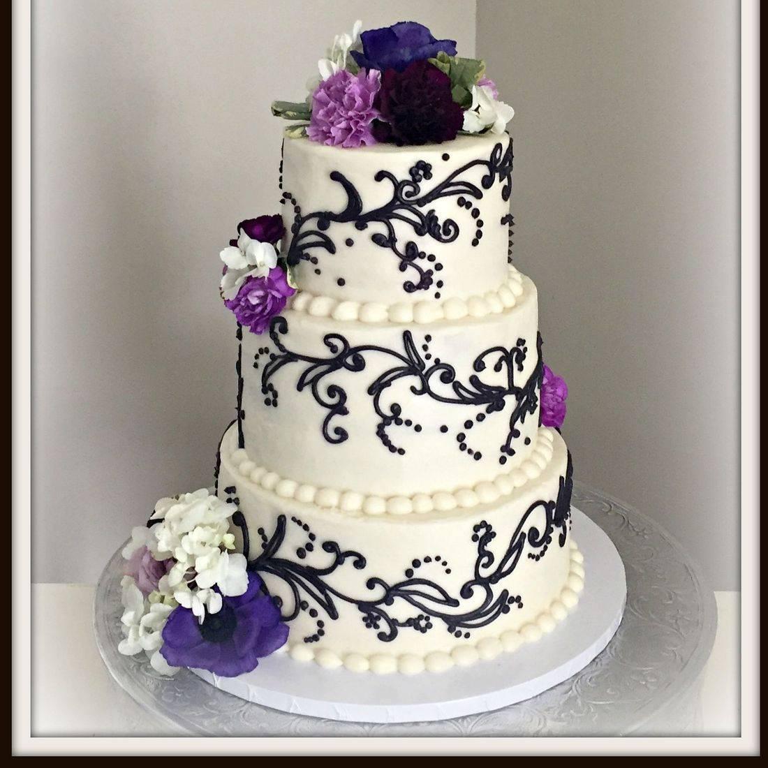 Buttercream Wedding Cake black scrolls purple