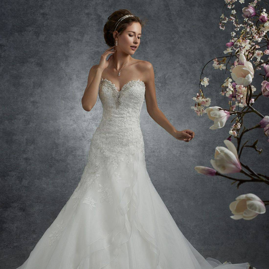 Sophia Tolli, sophia tolli wedding dress, a line wedding dress, fit and flare wedding dress, side panel wedding dress, chapel length train, lace, sparkle, sweetheart neckline, lace up back, corset back