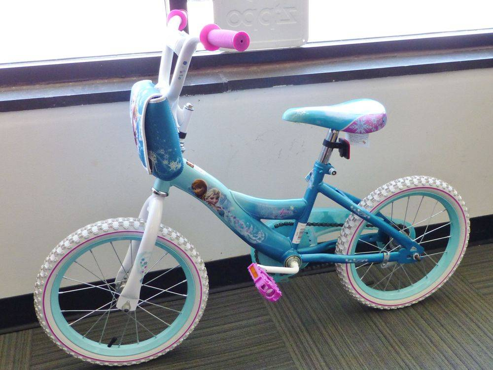 Closeup picture of a huffy girls pink, teal and white Disney Frozen Bike