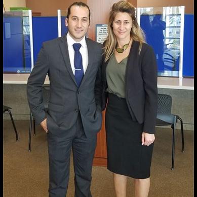 Emel Ersan with a client after winning their case