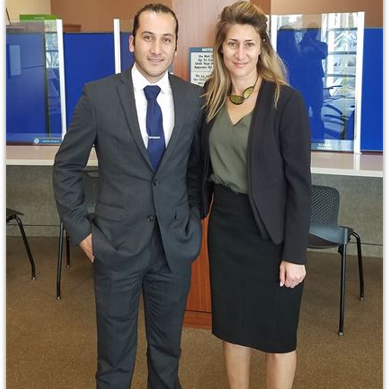 Emel Ersan with a client after winning their case