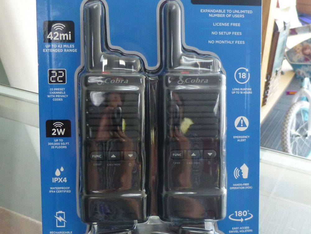 close up picture of a pair of Cobra Pro Business Walkie Talkies in a blue package