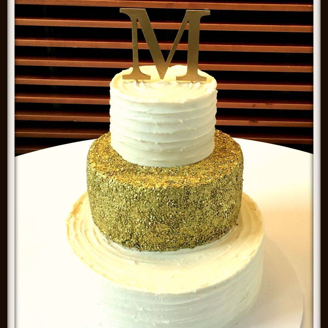 Wedding cake white modern with gold sequins gold and white