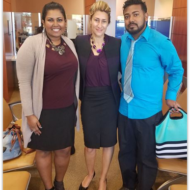 Emel Ersan with her clients after winning their case