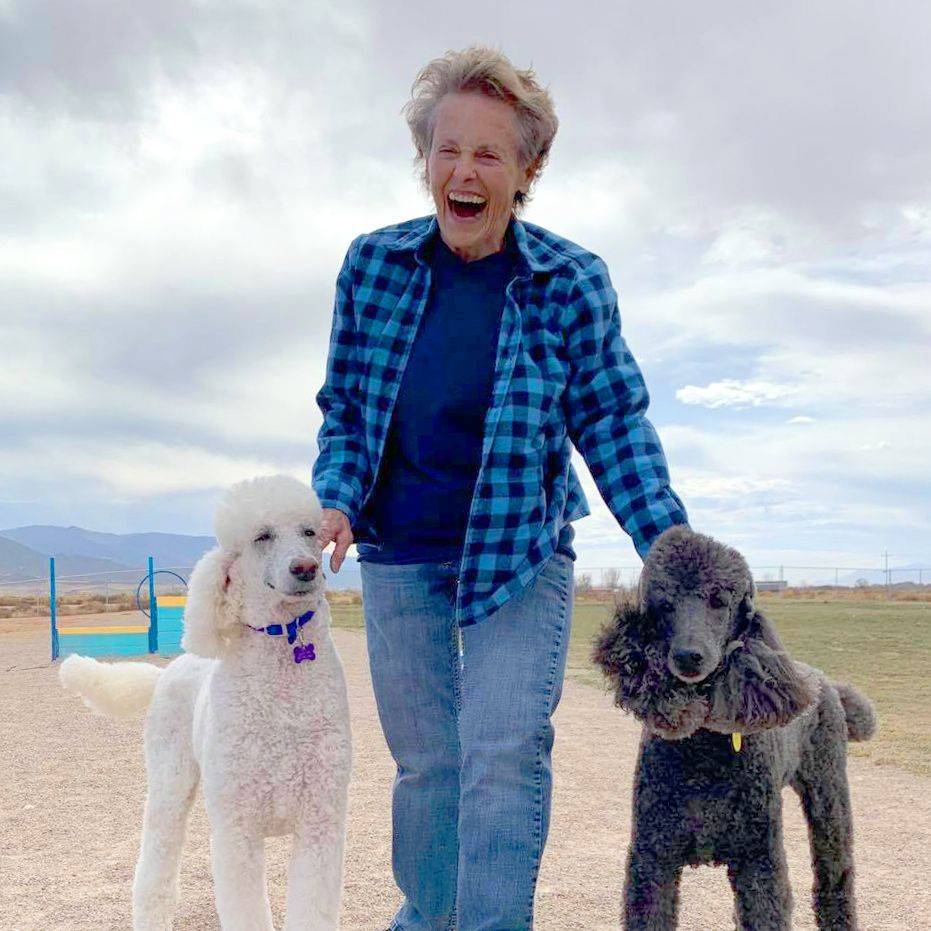 Woman with two poodles