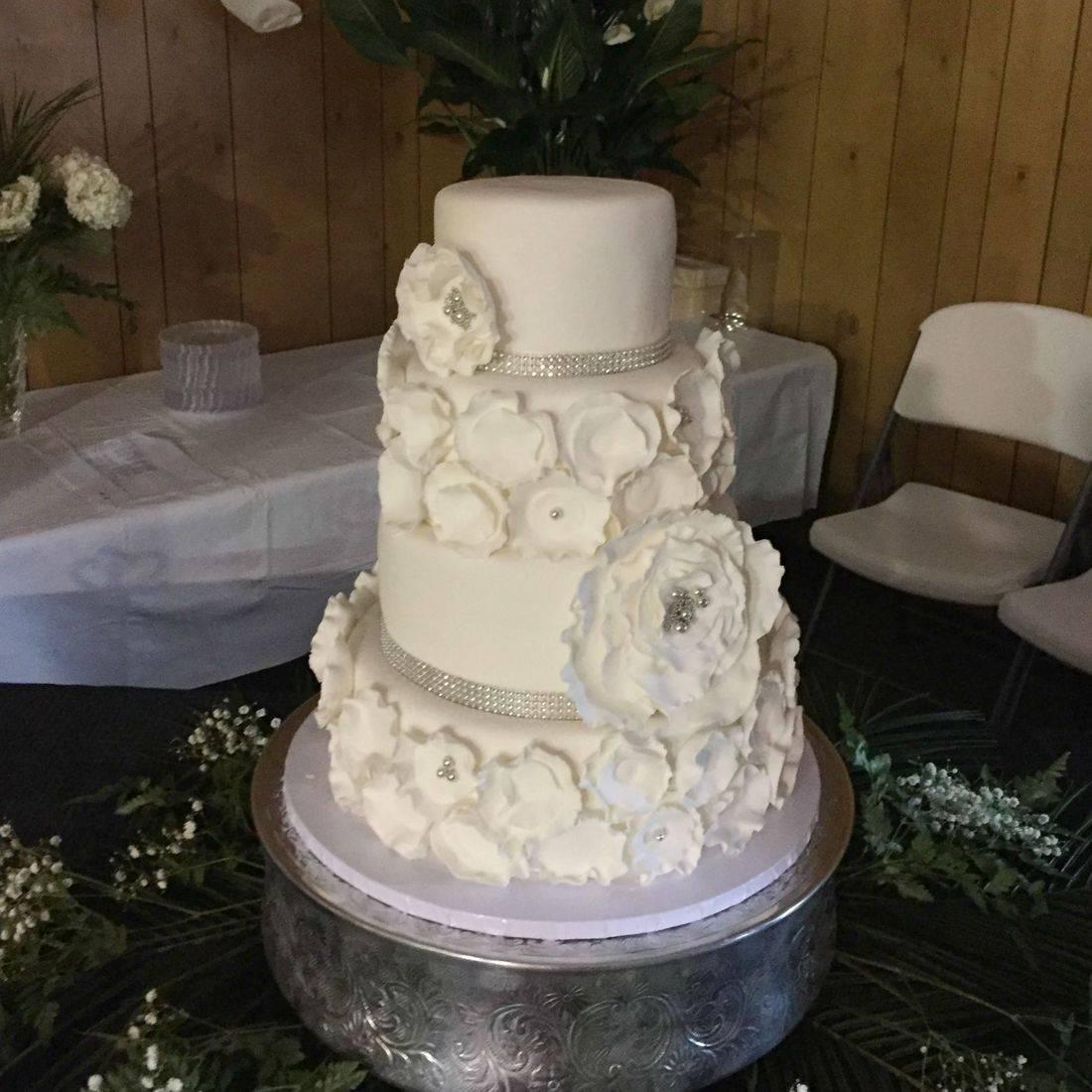 Wedding cake white modern flowers silver crystals