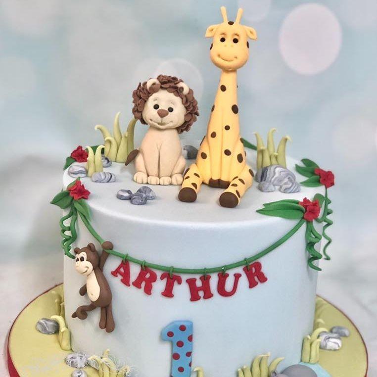 Jungle Safari Cake lion giraffe monkey hippo vines