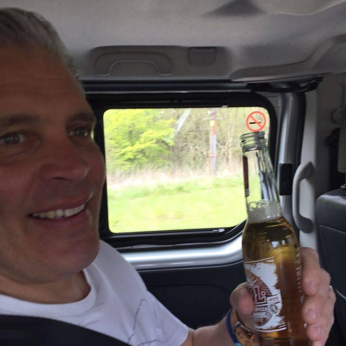 Man having a drink in a minibus