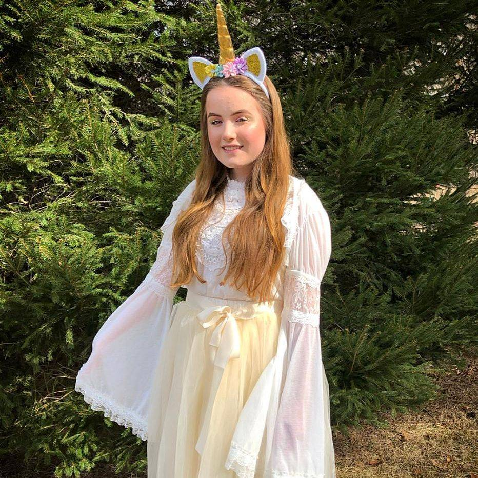Girl dressed as a unicorn princess
