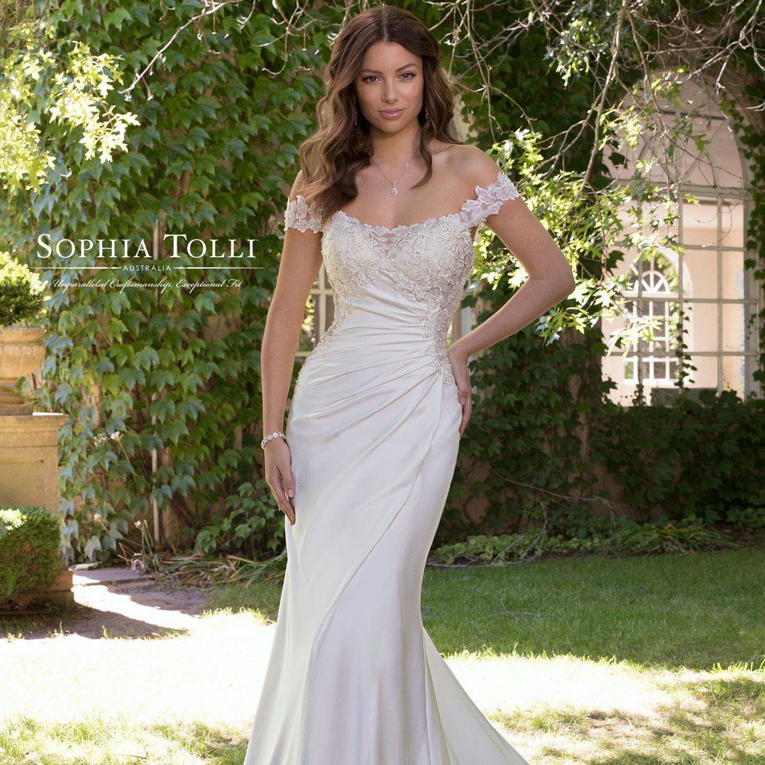 detachable straps, lace up back, corset back, crepe, satin, cut out hem, chapel length train, comfortable, stunning, unique, wedding dress, strapless, ruched, fitted, fit and flare, straps