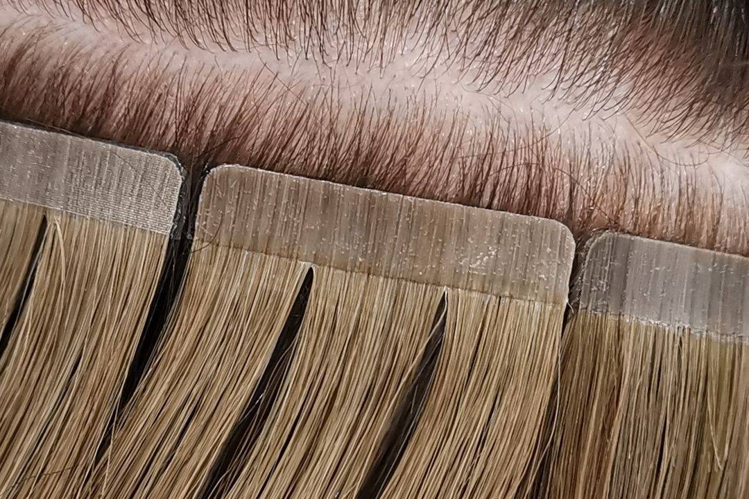 Close Up of standard hair extension tape fitted