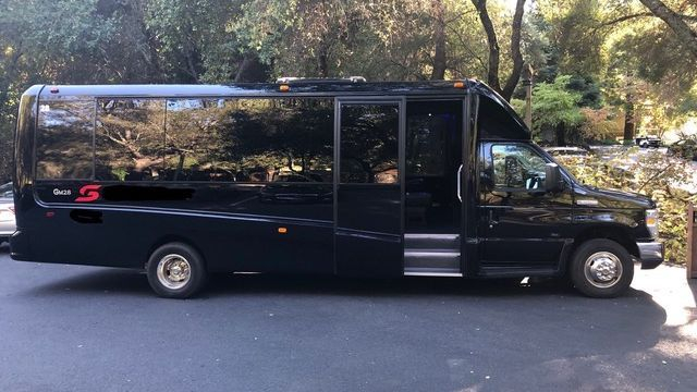 A 23 Passenger Executive Coach Bus  from Napa Sonoma Wine Tasting Driver.