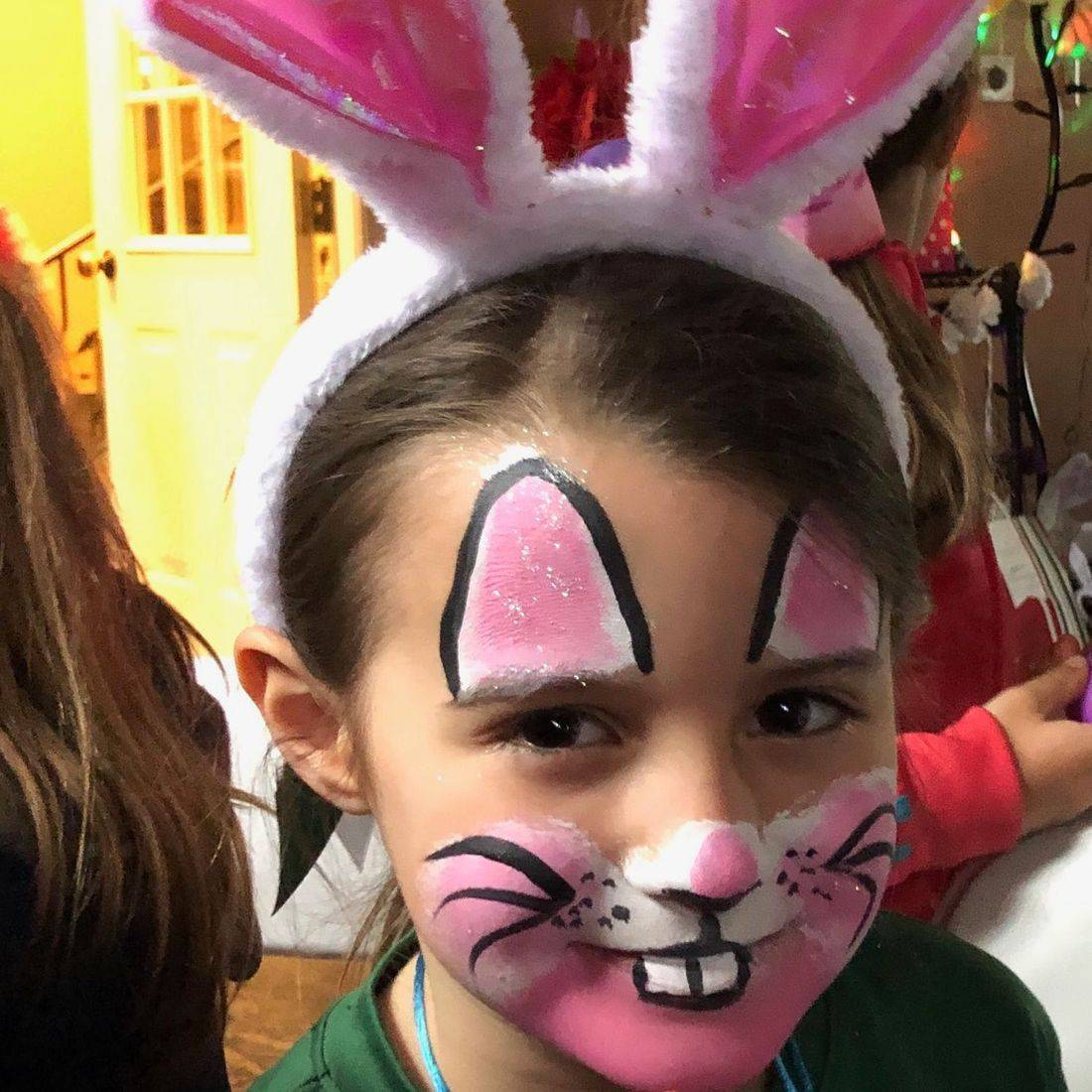 Girl with a bunny rabbit face paint