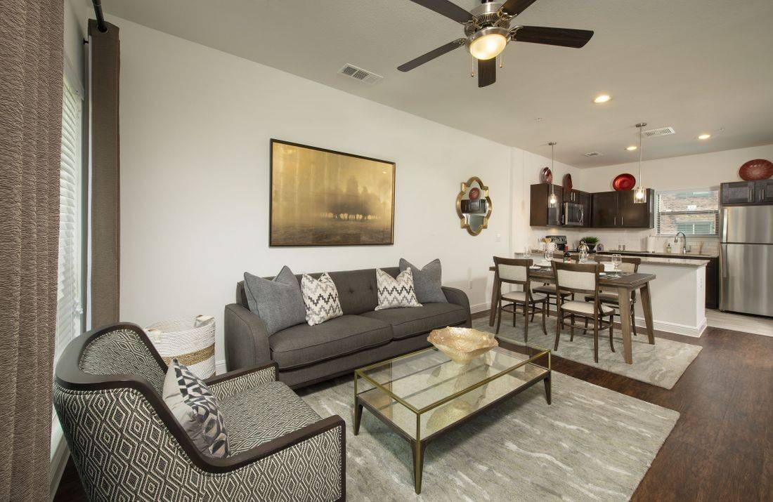 image of living room and kitchen of townhome in Pearland