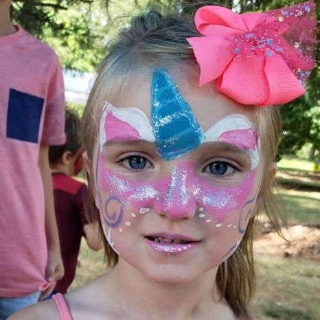 Little girl with a unicorn face paint